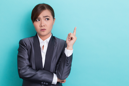 Serious woman on isolated background Stock Photo