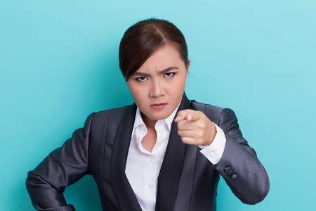 insult: Angry woman on isolated background