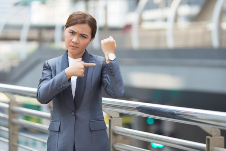 Angry businesswoman check her watch Stok Fotoğraf