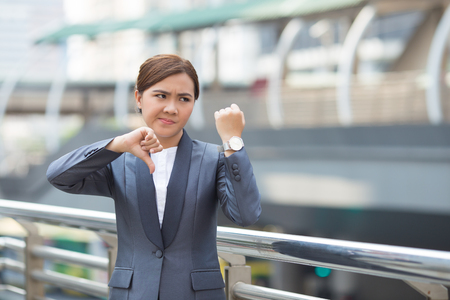 reminding: Angry businesswoman check her watch Stock Photo