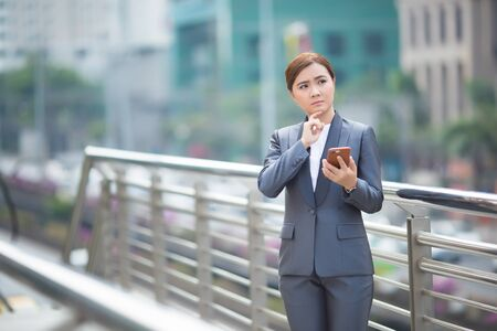 Businesswoman use smartphone and has nagative thinking