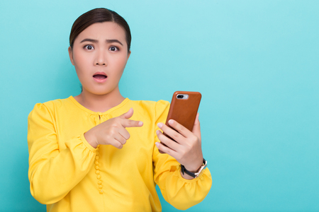 Woman look at smartphone and she shocked
