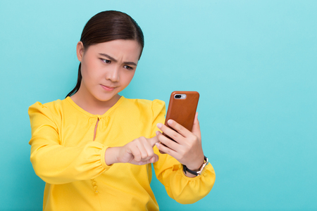 Woman use the smartphone and she feel angry