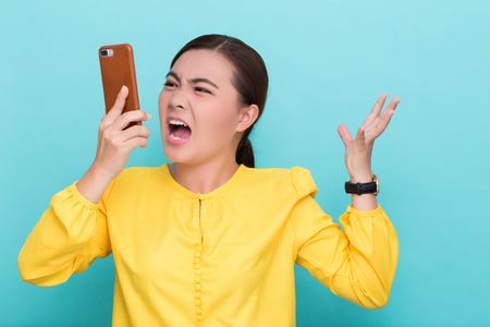Woman calling the smartphone and she feel angry