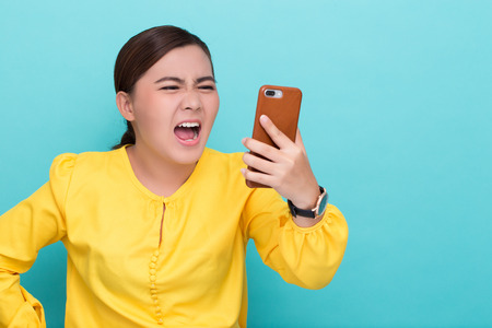 Woman shouting to the smartphone