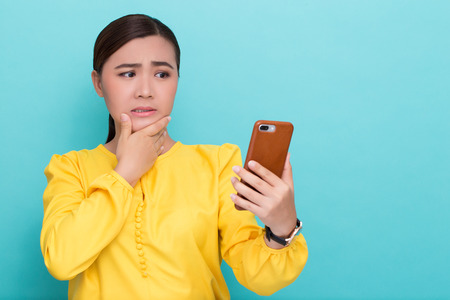 Woman look at smartphone and she scared Stock Photo