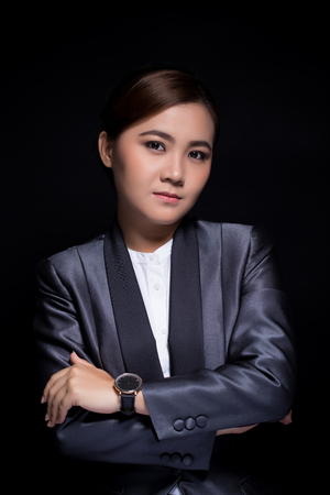 Scheming businesswoman planing something isolated on black background