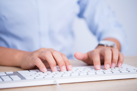 peripherals: Female hands typing on the keyboard Stock Photo