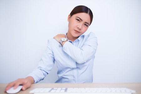 Woman has shoulder pain from work