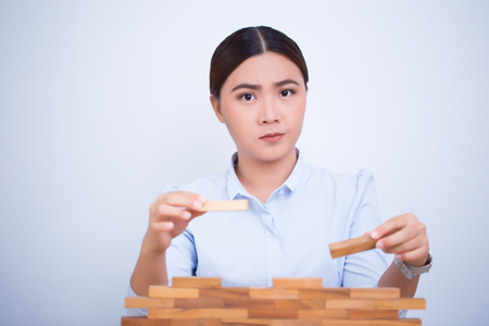 Asian woman planning build a tower puzzle
