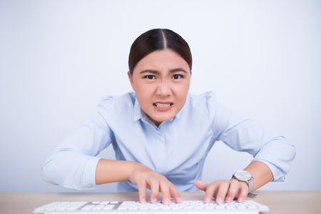 Crazy woman with hands on keyboard Stock Photo
