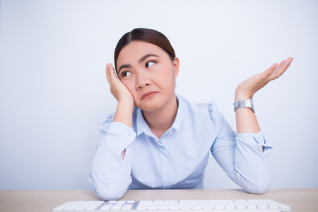 Woman use the computer and she feel boring