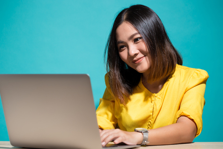 Woman feel shy when she look at laptop