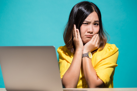 Woman so sad when she look at laptop