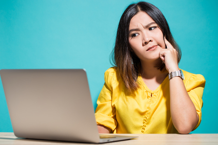 Woman has doubt when she look at laptop