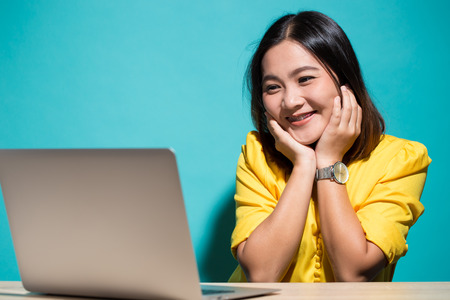 Happy woman when she look at laptop