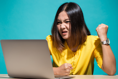 Angry woman when she look at laptop