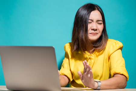Woman has shock when she look at laptop Stock Photo