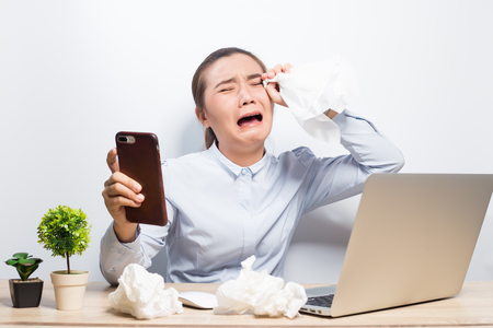 Woman cry when she look at smartphone
