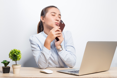 Woman use smartphone at office