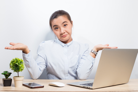 Woman show disgust when she look at laptop Stock Photo