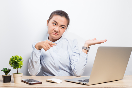 Woman show disgust when she look at laptop 写真素材