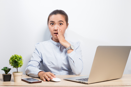 Woman gossip when she look at laptop