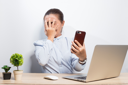 Woman scared when she look at smartphone