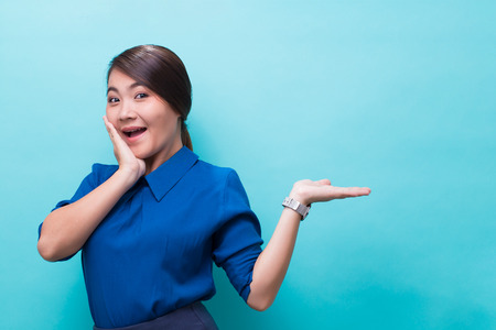 Asian woman showing gesture on isolated background
