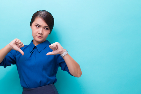 Serious woman showing hand stop gesture on isolated background