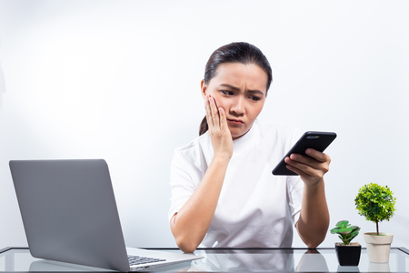 Woman has confused at office Stock Photo