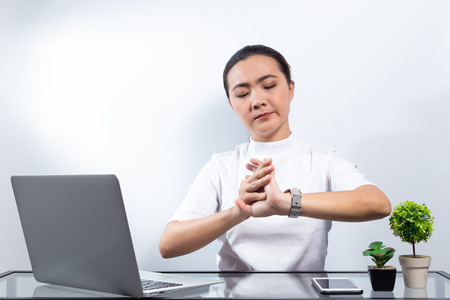 Woman has hand pain at office