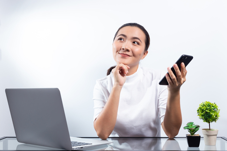 Woman use smart phone and happy