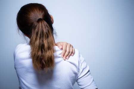 Woman has neck pain and injury Stockfoto