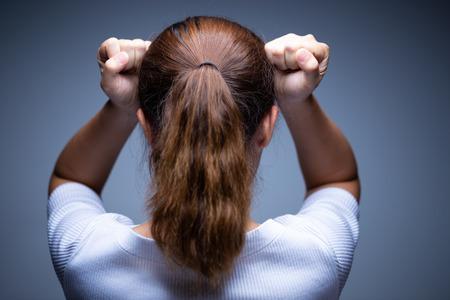 Woman has headache Imagens