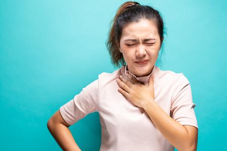 Woman feeling sick with sore throat