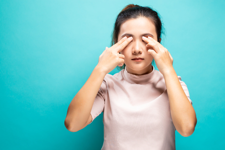 Woman suffering from eye pain Stock Photo
