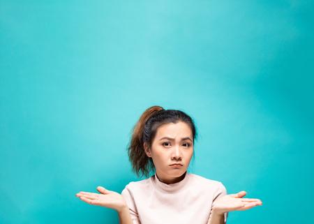 Portrait of serious woman on a blue background Reklamní fotografie - 115184176