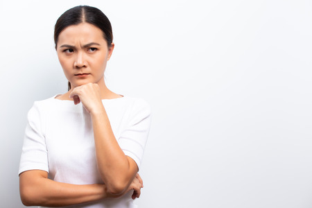 Angry woman standing isolated over white