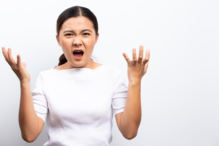Woman screaming standing isolated over white Stock Photo