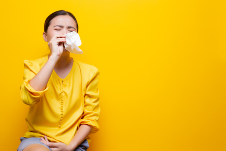 Sad woman crying and wipe her tears by tissue paper 写真素材