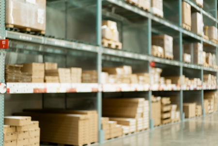 Warehouse interior and rows of shelves with boxes