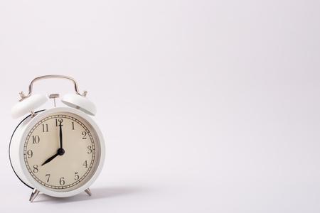 White alarm clock isolated on white background Stock Photo
