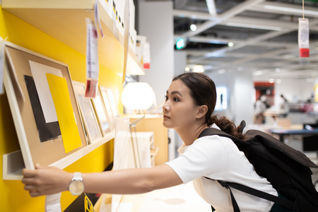 Woman shopping and choose the decorative for home office