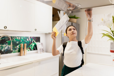 Woman shopping and choose the decorative for kitchen room