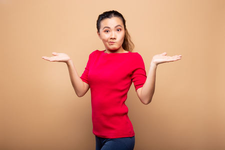Woman feel confused isolated on background Stock Photo