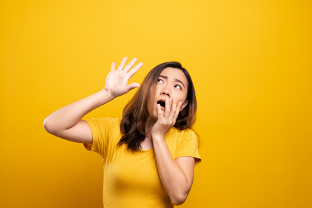 Woman feel scared standing isolated over yellow background Stock Photo