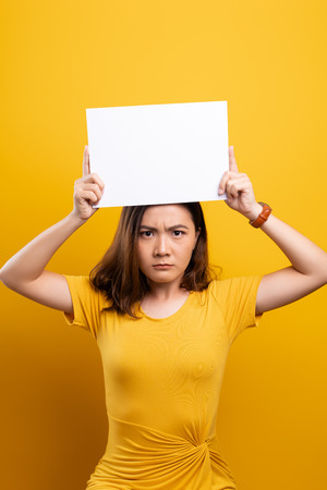Angry woman covering face with paper Stock Photo