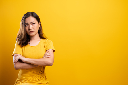 Angry woman isolated over yellow background