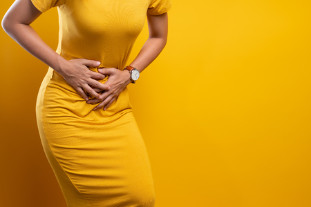 Woman suffers from stomach ache Close up Stockfoto - 119819865